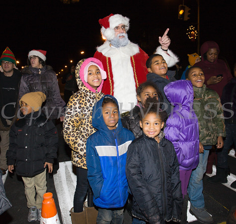 Children welcome Santa Claus as the City of Newburgh welcomed its Broadway tree during its official dedication and tree lighting ceremony on Wednesday, December 14, 2016. Hudson Valley Press/CHUCK STEWART, JR.