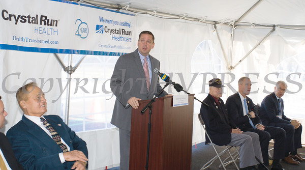 Orange County Executive Steve Neuhaus offers remarks as Crystal Run Healthcare celebrated the grand opening of, and cut the ribbon at, their new facility in the Village of Monroe on November 1, 2016. Hudson Valley Press/CHUCK STEWART, JR.