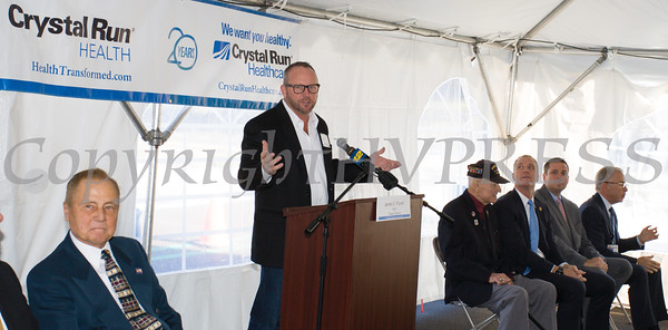 Village of Monroe Mayork James Purcell offers remarks as Crystal Run Healthcare celebrated the grand opening of, and cut the ribbon at, their new facility in the Village of Monroe on November 1, 2016. Hudson Valley Press/CHUCK STEWART, JR.