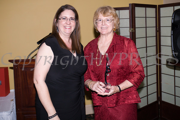 Annette Marzan presents Dr. Karen Eberle-McCarthy her award during the Newburgh Girl Power Program at St. George's Episcopal Church third annual Leadership Awards Dinner on Friday, November 11, 2016 at the Powelton Club in Newburgh, NY. Photo Credit: CHUCK STEWART, JR.
