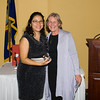 Mariel Fiori, Managind Edior of La Voz receives her award from Tina Robi during the Newburgh Girl Power Program at St. George's Episcopal Church third annual Leadership Awards Dinner on Friday, November 11, 2016 at the Powelton Club in Newburgh, NY. Photo Credit: CHUCK STEWART, JR.