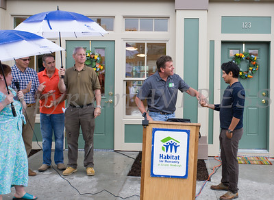 New home and business owner Ignacio Acevedo receives the keys to his new home from Andy Stahl during Habitat for Humanity of Greater Newburgh's 5th Builders Blitz in the City of Newburgh on Saturday, June 11, 2016. Hudson Valley Press/CHUCK STEWART, JR.