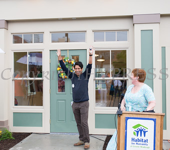 Ignacio Acevedo is excited after receiving the keys to his new home and business from Cathy Collins, Habitat Newburgh Executive Director, following Habitat for Humanity of Greater Newburgh's 5th Builders Blitz in the City of Newburgh on Saturday, June 11, 2016. Hudson Valley Press/CHUCK STEWART, JR.
