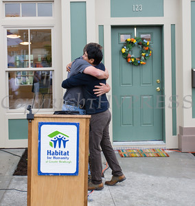 Andy Stahl of Hearthstone Contracting, and Chair of the Builders Blitz, hugs new business and homeowner Ignacio Acevedo during Habitat for Humanity of Greater Newburgh's 5th Builders Blitz in the City of Newburgh on Saturday, June 11, 2016. Hudson Valley Press/CHUCK STEWART, JR.