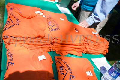 Walkers received t-shirts prior to participating in Habitat for Humanity of Greater Newburgh's 17th Annual Walk for Housing in the City of Newburgh on Sunday, April 17, 2016. Hudson Valley Press/CHUCK STEWART, JR.