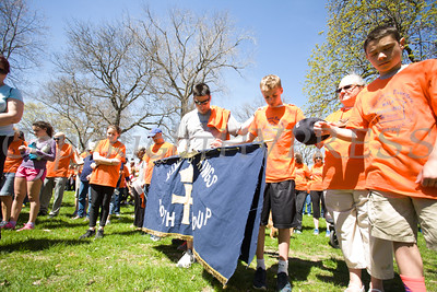 Walkers lower their heads during a prayer prior to Habitat for Humanity of Greater Newburgh's 17th Annual Walk for Housing in the City of Newburgh on Sunday, April 17, 2016. Hudson Valley Press/CHUCK STEWART, JR.
