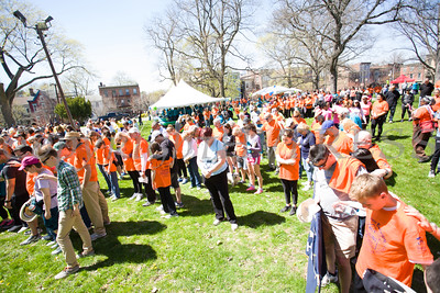 Those gathered for Habitat for Humanity of Greater Newburgh's 17th Annual Walk for Housing in the City of Newburgh on Sunday, April 17, 2016 lower their heads as a prayer is said prior to the walk. Hudson Valley Press/CHUCK STEWART, JR.