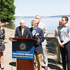 Riverkeeper President Paul Gallay offers remarks as local elected officials called on the US Coast Guard to hold additional public hearings and conduct an environmental impact study before expanding mooring infrastructure on the Hudson River during a press conference at Plumb Point in New Windsor on Thursday, August 18. Hudson Valley Press/CHUCK STEWART, JR.