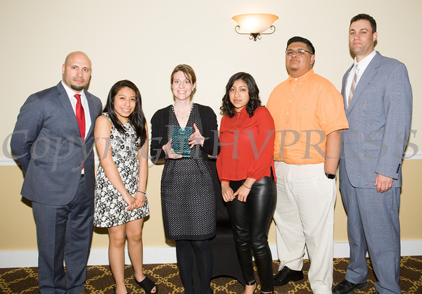 Award honoree Jacqueline Hesse with Newburgh Enlarged City School District Superintendent Roberto Padilla (left), students and Principal Kevin Rothman (right) at the 21st Annual Orange County Human Rights Commission Awards Dinner held on Thursday, April 21st at The Fountains of Wallkill. Hudson Press/CHUCK STEWART, JR.