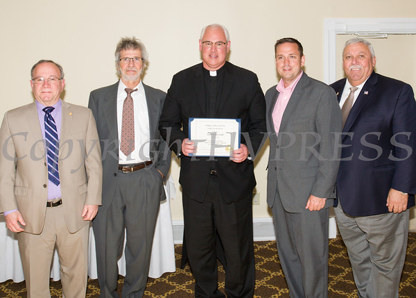 Orange County Legislator Jeffrey D. Berkman, Orange County Minority Leader Matthew A. Turnbull, award honoree Father Mark Connell, Orange County Executive Steven M. Neuhaus, and Orange County Legislator James M. Kulisek at the 21st Annual Orange County Human Rights Commission Awards Dinner held on Thursday, April 21st at The Fountains of Wallkill. Hudson Press/CHUCK STEWART, JR.