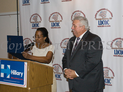 LDCOC Treasurer Vanessa Tirado reads a certificate of recognition for honoree Orange County Legislator James Kulisek during the Latino Democratic Committee of Orange County Thirteenth Annual Fall Dinner Dance at Cafe Internationale in Newburgh, NY on Saturday, October 15, 2016. Hudson Valley Press/CHUCK STEWART, JR.