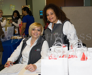 MVP Health Care's Marisol Guzman and Milagros Torres greet people as they arrive for a Mother's Day Celebration at Cornerstone Family Healthcare on Saturday, May 7, 2016. Hudson Valley Press/CHUCK STEWART, JR.