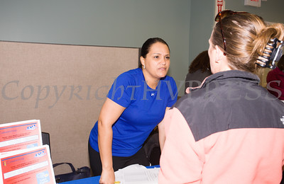 Orange-Ulster BOCES Litercay Zone Case Manager Yelitza Nolasco talks to attendees of the MVP Health Care sponsored Mother's Day Celebration at Cornerstone Family Healthcare on Saturday, May 7, 2016. Hudson Valley Press/CHUCK STEWART, JR.