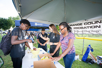 Orange County Probation Officers John, Carmen and Martena hand out goodies during the 19th year of the all-free National Night Out event in the City of Newburgh on Tuesday, August 2, 2016. Hudson Valley Press/CHUCK STEWART, JR.