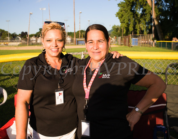 Marisol Guzman and Janet Hernandez of MVP Health Care hand out information during the 19th year of the all-free National Night Out event in the City of Newburgh on Tuesday, August 2, 2016. Hudson Valley Press/CHUCK STEWART, JR.