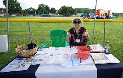 Sarah Shidid from Cornerstore Family Healthcare hands out information during the 19th year of the all-free National Night Out event in the City of Newburgh on Tuesday, August 2, 2016. Hudson Valley Press/CHUCK STEWART, JR.