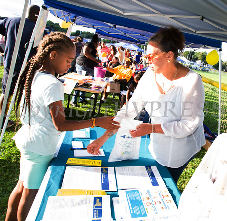 Ramona Burton from MISN hands out information during the 19th year of the all-free National Night Out event in the City of Newburgh on Tuesday, August 2, 2016. Hudson Valley Press/CHUCK STEWART, JR.