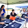 Theresa Cayton, Isabel Rojas and Leah Canton hand out information from the Orange County District Attorney's Office during the 19th year of the all-free National Night Out event in the City of Newburgh on Tuesday, August 2, 2016. Hudson Valley Press/CHUCK STEWART, JR.