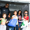 Police Officer Perez gives kids a tour of a police vehicle during the 19th year of the all-free National Night Out event in the City of Newburgh on Tuesday, August 2, 2016. Hudson Valley Press/CHUCK STEWART, JR.