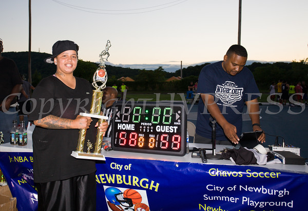 Basketball Tournament champion coach pose with trophy during the 19th year of the all-free National Night Out event in the City of Newburgh on Tuesday, August 2, 2016. Hudson Valley Press/CHUCK STEWART, JR.