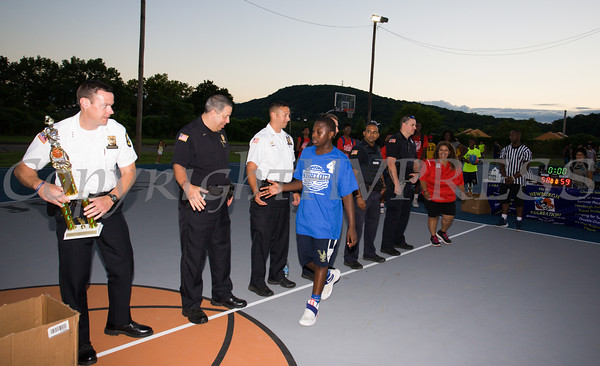 City of Newburgh Police Chief Daniel Cameron and members of the police department were on hand to greet tournament players during the 19th year of the all-free National Night Out event in the City of Newburgh on Tuesday, August 2, 2016. Hudson Valley Press/CHUCK STEWART, JR.