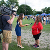 Maritza Wilson is interviewed by a local television station during the 19th year of the all-free National Night Out event in the City of Newburgh on Tuesday, August 2, 2016. Hudson Valley Press/CHUCK STEWART, JR.