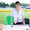Lesly Retamozo of Cornerstone Family Healthcare hands out information during the 19th year of the all-free National Night Out event in the City of Newburgh on Tuesday, August 2, 2016. Hudson Valley Press/CHUCK STEWART, JR.