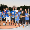 Basketball Tournament champions pose with police officers and recreation staff during the 19th year of the all-free National Night Out event in the City of Newburgh on Tuesday, August 2, 2016. Hudson Valley Press/CHUCK STEWART, JR.
