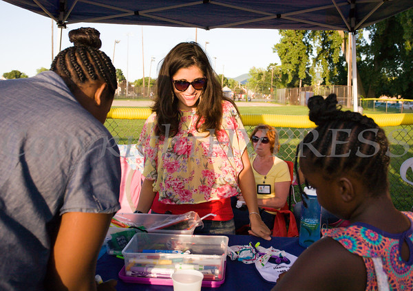 Natasha Carmona of Access: Supports for Living engages youth during the 19th year of the all-free National Night Out event in the City of Newburgh on Tuesday, August 2, 2016. Hudson Valley Press/CHUCK STEWART, JR.
