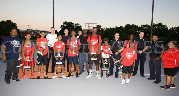 Basketball Tournament players pose with police officers and recreation staff during the 19th year of the all-free National Night Out event in the City of Newburgh on Tuesday, August 2, 2016. Hudson Valley Press/CHUCK STEWART, JR.