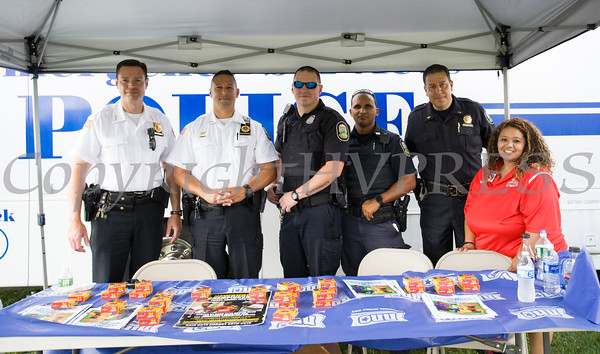 City of Newburgh Police Chief Daniel Cameron, left, with officers and organizer Maritza Wilson at the 19th year of the all-free National Night Out event in the City of Newburgh on Tuesday, August 2, 2016. Hudson Valley Press/CHUCK STEWART, JR.