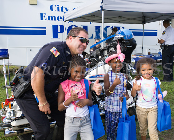 """Kids received a """"badge"""" from P.O. Vasta during the 19th year of the all-free National Night Out event in the City of Newburgh on Tuesday, August 2, 2016. Hudson Valley Press/CHUCK STEWART, JR."""