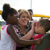 Tyra Thompson from the Orange County Youth Bureau paints three-year-old Gio's face during the 19th year of the all-free National Night Out event in the City of Newburgh on Tuesday, August 2, 2016. Hudson Valley Press/CHUCK STEWART, JR.