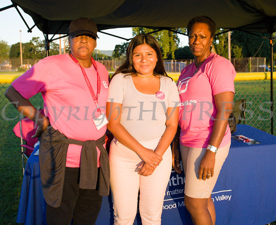 Deborah Danzy, Aura and Lana Williams-Scott of Planned Parenthood Mid Hudson Valley hand out information during the 19th year of the all-free National Night Out event in the City of Newburgh on Tuesday, August 2, 2016. Hudson Valley Press/CHUCK STEWART, JR.