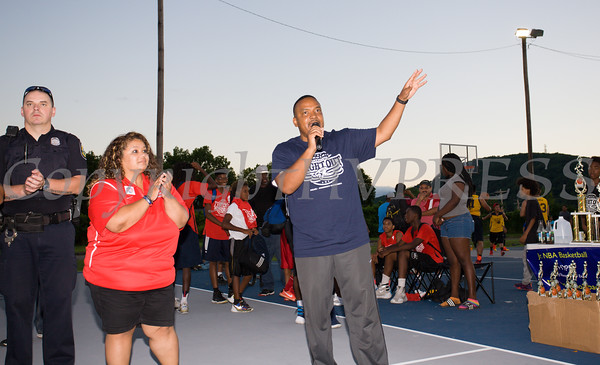 Derrick Stanton, Recreation Director announces the winners of the basketball tournament for the 19th year of the all-free National Night Out event in the City of Newburgh on Tuesday, August 2, 2016. Hudson Valley Press/CHUCK STEWART, JR.