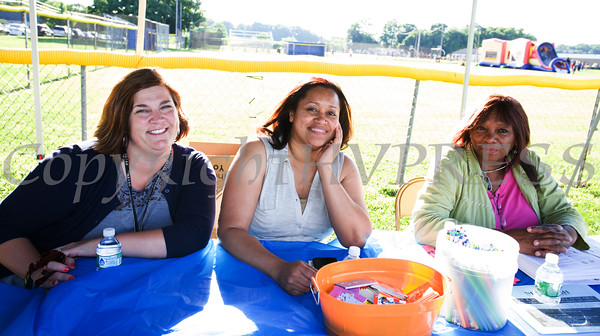 At the Newburgh Enlarged City School District table are GAMS Principal Tara Marshall, Pamela Buxton-Peterson, and Gwen Licameli for the 19th year of the all-free National Night Out event in the City of Newburgh on Tuesday, August 2, 2016. Hudson Valley Press/CHUCK STEWART, JR.