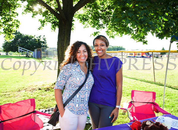 Jessica Hernandez and Sarita Green from Orange County Safe Homes, hand out information during the 19th year of the all-free National Night Out event in the City of Newburgh on Tuesday, August 2, 2016. Hudson Valley Press/CHUCK STEWART, JR.