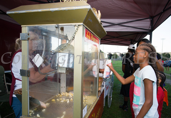 Children enjoy popcorn during the 19th year of the all-free National Night Out event in the City of Newburgh on Tuesday, August 2, 2016. Hudson Valley Press/CHUCK STEWART, JR.