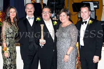 Derrik Wynkoop, center, accepts the Lifetime Achievement Pillar from Lisa Sommers, Marcel Martino, Linda S. Muller and Josh Sommers during Cornerstone Family Healthcare's 17th Annual Pillars of the Community Gala held at Anthony's Pier 9 on Saturday, November 5, 2016. Hudson Valley Press/CHUCK STEWART, JR.