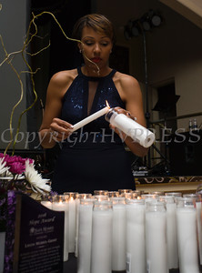 Sarita Green lights a candle for each life lost to domestic violence in Orange County as Safe Homes of Orange County celebrated its 30th Anniversary with a Celebration of Hope Gala on Friday, October 21, 2016. Hudson Valley Press/CHUCK STEWART, JR.