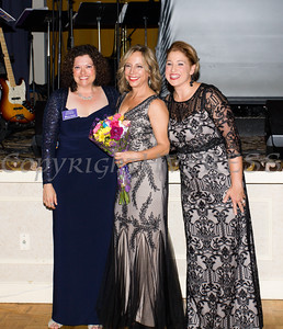 Safe Homes Board of Directors Chair Christine Fitzgerlad, presents flowers to Safe Homes Development Director Christa Orsino along with Safe Homes Executive Director Kellyann Kostyal-Larrier as Safe Homes of Orange County celebrated its 30th Anniversary with a Celebration of Hope Gala on Friday, October 21, 2016. Hudson Valley Press/CHUCK STEWART, JR.