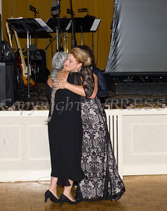 The Jane Chertock Legacy Award recipient Dr. Marie Cantu is embraced by Safe Homes Executive Director Kellyann Kostyal-Larrier as Safe Homes of Orange County celebrated its 30th Anniversary with a Celebration of Hope Gala on Friday, October 21, 2016. Hudson Valley Press/CHUCK STEWART, JR.