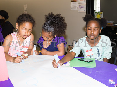 Youth work on projects during the Newburgh Sunrise Coalition sponsored workshops at the Newburgh Armory Unity Center in Newburgh on Saturday, April 23, 2016. Hudson Valley Press/CHUCK STEWART, JR.