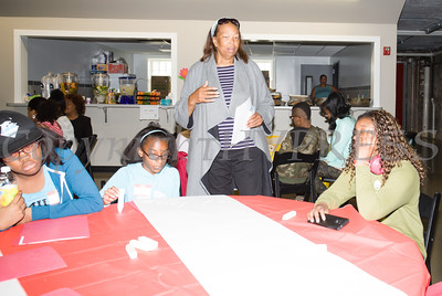 Cheryl Farella talks with the youth who attended the Newburgh Sunrise Coalition's lunch and workshops at the Newburgh Armory Unity Center in Newburgh on Saturday, April 23, 2016. Hudson Valley Press/CHUCK STEWART, JR.