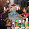Youth prepare for a nutirtional workshop during the Newburgh Sunrise Coalition sponsored workshops at the Newburgh Armory Unity Center in Newburgh on Saturday, April 23, 2016. Hudson Valley Press/CHUCK STEWART, JR.