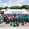 Youth pose for a group photo with City of Newburgh Police Officers Dan D'Elicio and Curtis Hahne, K-9 Tank Tebow, and TEAM Newburgh partners following a fun filled day for the youth at Algonquin Park in Newburgh on Friday, July 15, 2016. Hudson Valley Press/CHUCK STEWART, JR.