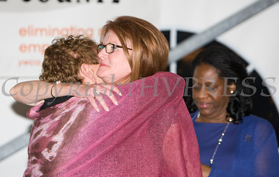 Florence Bluegrass-Hannes embraces Honoree Joan Cusack-McGuirk during the 24th Annual Tribute to Women of Achievement of Orange County held at West Hills Country Club in Middletown, NY on Wednesday, May 11, 2016. Hudson Press/CHUCK STEWART, JR.