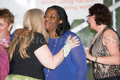 Honoree Katherine Fox is embraced by Pamela Anderson during the 24th Annual Tribute to Women of Achievement of Orange County held at West Hills Country Club in Middletown, NY on Wednesday, May 11, 2016. Hudson Press/CHUCK STEWART, JR.