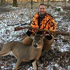 ANOTHER SHOT OF JOE WITH  HIS FIRST BUCK WITH MUZZLE LOADER