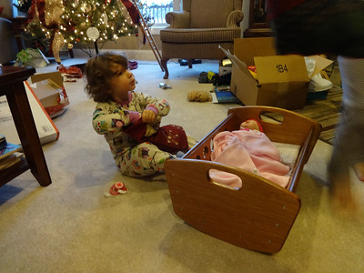 "ELLIE SURE LOVES HER DOLL-CRIB .  THE INSIDE-BOTTOM OF THE CRIB IS 10"" X 20""  CHRISTMAS 2013"